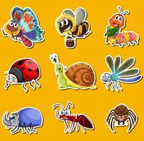Klistermärke med många insekter på gul bakgrund