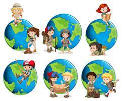 Sats av barn och glober vektor