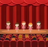 Eine Gruppe Mädchen, die auf der Bühne durchführen vektor
