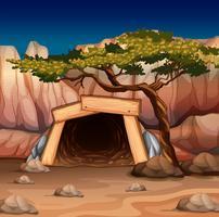 Szene mit Mineneingang und Baum
