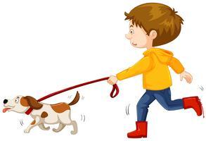 Liten pojke walking hund