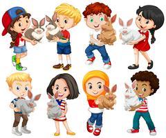 Jungen und Mädchen mit Kaninchenhaustier vektor