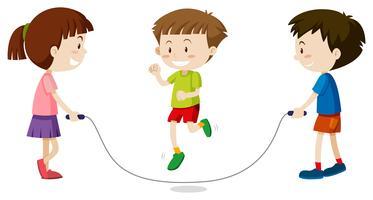 Drei Kinder springen Seil