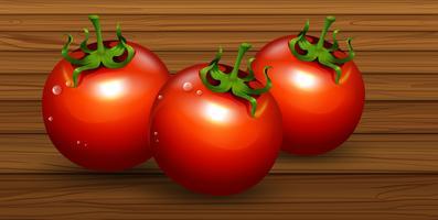 Eine frische organische Tomate auf hölzernem Hintergrund vektor