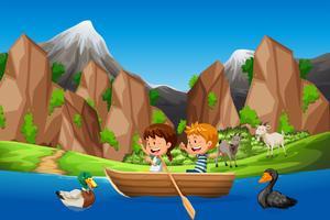 Barn paddla båt i naturen