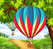 Cgroup av barn som kör varmluftsballong