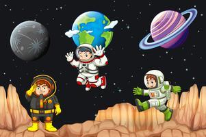 Tre astronauter som flyger i rymden