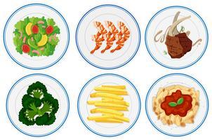 Olika typer av mat på tallrikar