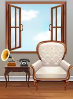 Rum med vit fåtölj och vintage telefon
