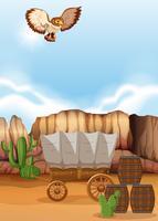 Uggla som flyger över vagnen i öknen