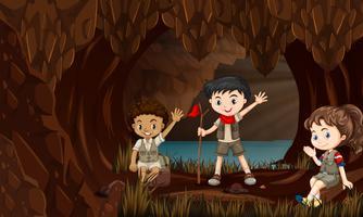 Barn i en grotta vektor