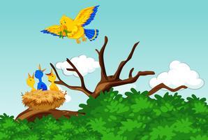 Morfågel som matar barnen med maskar vektor