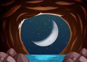 En vattengrotta landskap på natten