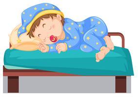 Barn som sover på sängen