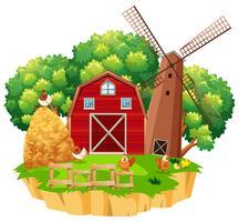 Gårdsplats med röd ladugård och trä vindkraftverk