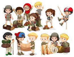 Pojkar och tjejer i camping outfit vektor