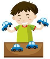 Liten pojke leker med leksaksbilar vektor