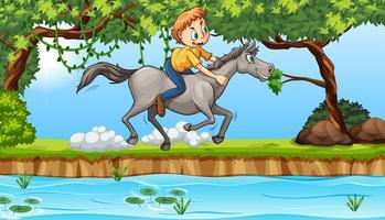 Junge, der ein Pferd reitet vektor