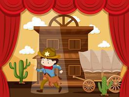 Pojke spelar cowboy på scenen