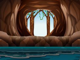 Grotta med ingång och vatten vektor