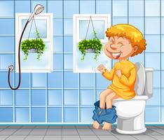 Ung pojke går på toaletten vektor