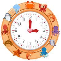 Eine Uhr mit Meerestier vektor