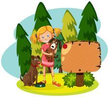 Flicka med två hundar skogscen