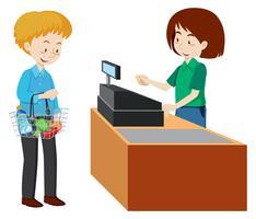 Ein Mann, der am Kassierer eines Supermarktes bezahlt