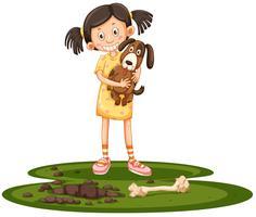 Ung tjej som håller sin hund