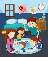 En familj leker leksak med barn