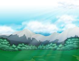 Scen med fält och berg på dagtid