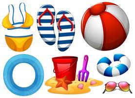 Strandbekleidung und anderes Strandspielzeug vektor