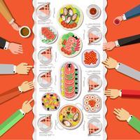 Cateringparty med händer i händerna och ett bord av rätter från menyn, ovanifrån.