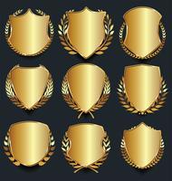 Guld och svart sköld med guld laureller