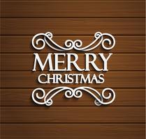 Frohe Weihnachten auf hölzernem Hintergrund.