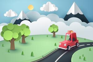 Papperskonst av röd bil landsväg skog och berg, origami och resor