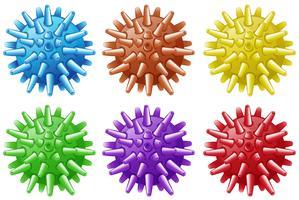 Sex bollar med spikar i olika färger