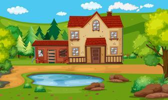 Gammalt hus med dammen på landet vektor