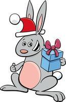 Cartoon Kaninchen Tier Charakter mit Geschenk zur Weihnachtszeit vektor