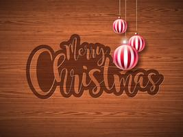 Frohe Weihnacht-Handbeschriftungs-Illustration mit Papieraufkleber und roten dekorativen Glaskugeln auf Weinlese-Holz-Hintergrund. Vektor ENV 10 Feiertagsauslegung.