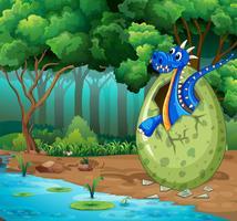 Skogscen med blå drakekläckande ägg