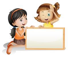 Två tjejer med en blank vit kartong vektor