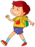 Pojke med grön ryggsäck som går