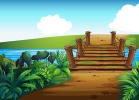 Bakgrundsscen med bro över strömmen