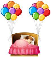 Tjej i sängen med färgglada ballonger på sidorna
