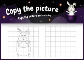 kopiere das bild kinderspiel und die ausmalseite mit einem süßen kaninchen mit halloween-kostüm vektor