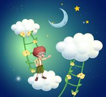 En pojke som står ovanför molnen