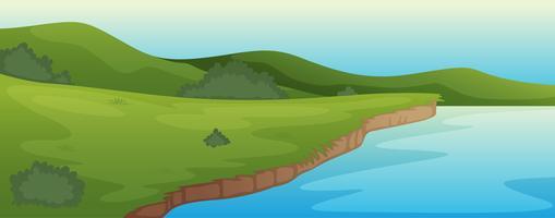 grüne Landschaft und See vektor