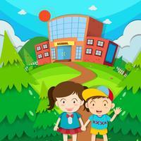 Studerande pojke och tjej i skolan