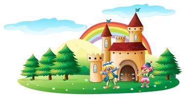 Zwei Clowns vor einer Burg vektor